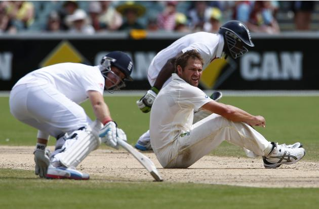 Australia's Harris looks on after a missed fielding as England's Root and Carberry run between wickets during the fourth day of the second Ashes test cricket match in Adelaide