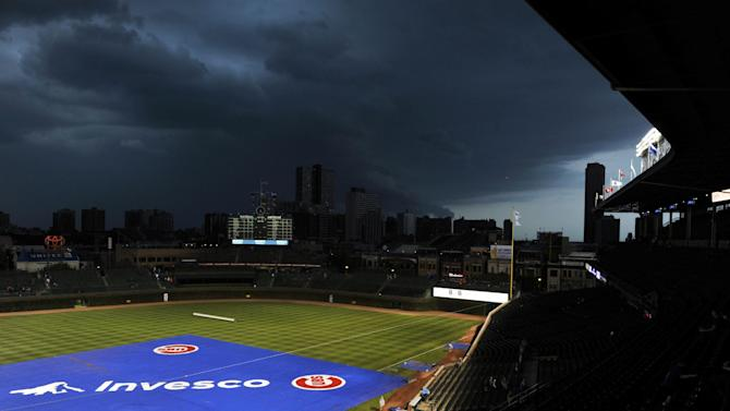 Storm clouds move over Wrigley Field delaying the start of a baseball game between the Pittsburgh Pirates and Chicago Cubs, Monday, Sept. 17, 2012, in Chicago. (AP Photo/Jim Prisching)