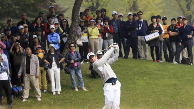 Rory McIlroy of Northern Ireland watches his shot on the second hole during the first round of the Korea Open golf tournament at Woo Jeong Hills Country Club in Cheonan, south of Seoul, South Korea, Thursday, Oct. 6, 2011. (AP Photo/Yonhap, Yang Young-suk) KOREA OUT