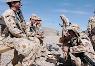 This file photo shows Australian soldiers of the NATO-led International Security Assistance Force (ISAF) having lunch at their base in Tirin Kot, the capital of Uruzgan province, in 2007. PM Julia Gillard said on Monday, news that local Afghan forces would take over control of security in a large new slice of the country was a real sign of progress
