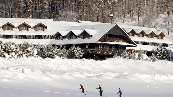 """This undated photo provided by the Trapp Family Lodge shows cross-country skiers outside the lodge  in Stowe, Vt. The lodge is owned by the famous singing family from """"The Sound of Music."""" Family-owned resorts like the Trapp Family Lodge try to provide a personal touch for guests in an era when many resorts are owned by large corporations. (AP Photo/Trapp Family Lodge)"""
