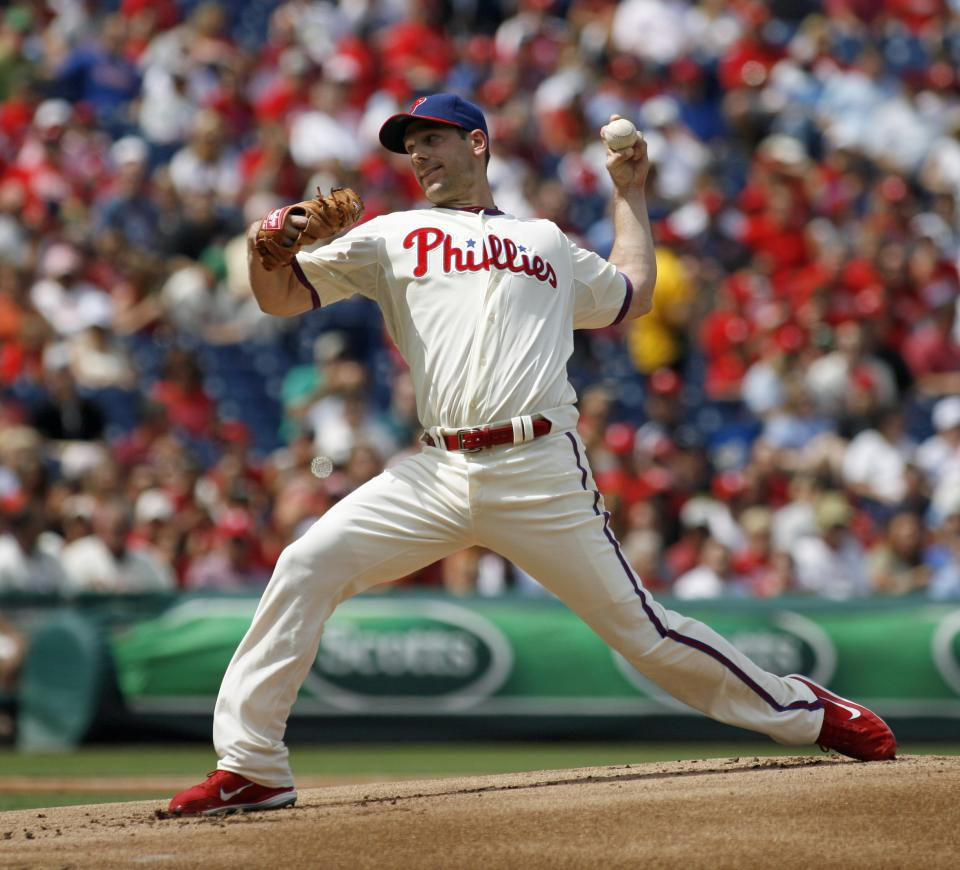 Philadelphia Phillies starting pitcher Cliff Lee throws against the Washington Nationals in the first inning of a baseball game on Sunday, Aug. 26, 2012, in Philadelphia. (AP Photo/H. Rumph Jr)