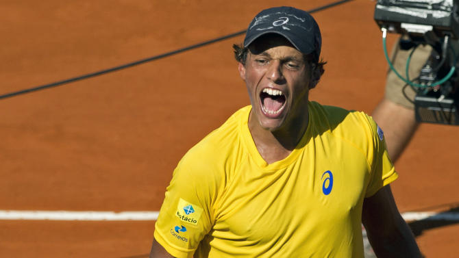 Brazil's Joao Souza celebrates his 6-4, 3-6, 5-7, 6-3, 6-2 victory over Argentina's Carlos Berlocq, at the end of a Davis Cup singles tennis match in Buenos Aires, Argentina, Friday, March 6, 2015. (AP Photo/Natacha Pisarenko)