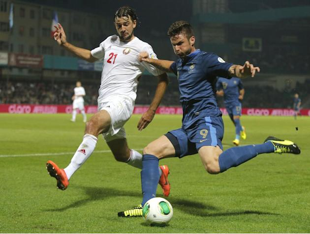 France's Olivier Giroud, right, challenges for the ball with Belarus' Yegor Filipenko  during their World Cup Group I qualifying soccer match in Gomel, Belarus, Tuesday, Sept. 10, 2013