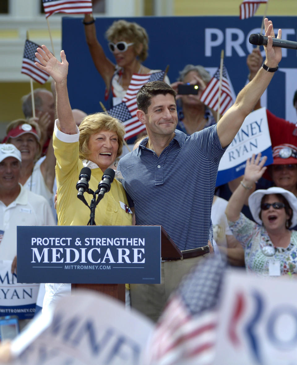 RETRANSMISSION FOR ALTERNATE CROP - Republican vice-presidential candidate Rep. Paul Ryan, R-Wis., center left, and his mother Betty Ryan Douglas wave to supporters at a campaign rally in The Villages, Fla., Saturday, Aug. 18, 2012.  (AP Photo/Phelan M. Ebenhack)