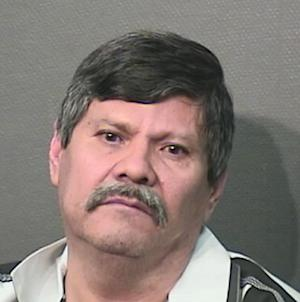 This booking photo provided by the Houston Police Department on Wednesday, April 23, 2014, shows Guillermo Correa. Police say, Correa, 56, a resident of a Houston nursing home will face capital murder charges for using the armrest of his wheelchair to beat two of his roommates to death. (AP Photo/Houston Police Department)