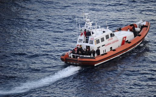 An Italian Coastguard ship is pictured in January 2012. A group of 160 Syrians travelling in a fishing boat arrived in the southern Italian port of Crotone on Wednesday, after being spotted offshore by the coastguard