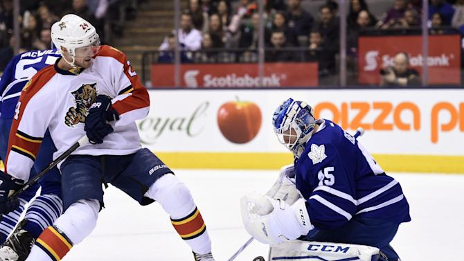 Toronto Maple Leafs goalie Jonathan Bernier makes a save as Florida Panthers' Brad Boyes (24) looks for a rebound during the first period of an NHL hockey game Thursday, March 26, 2015, in Toronto. (AP Photo/The Canadian Press, Frank Gunn)