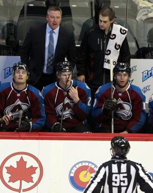 Colorado Avalanche head coach Patrick Roy, back left, argues with an official while facing the Anaheim Ducks in the first period of an NHL hockey game in Denver, Wednesday, Oct. 2, 2013. (AP Photo/David Zalubowski)
