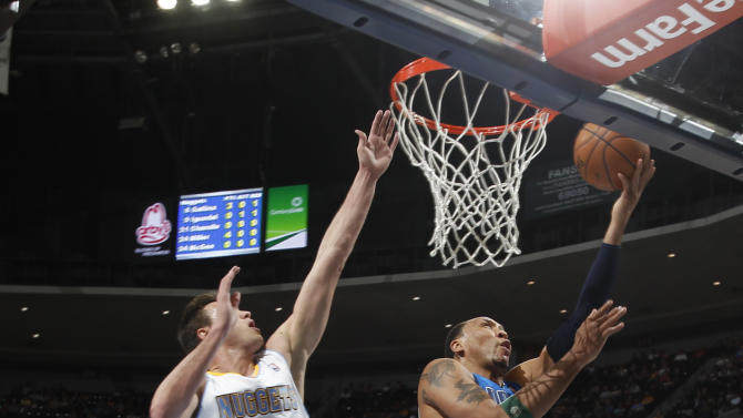 Dallas Mavericks forward Shawn Marion, right, goes up for a shot as Denver Nuggets forward Danilo Gallinari, of Italy, covers in the first quarter of an NBA basketball game in Denver on Thursday, April 4, 2013. (AP Photo/David Zalubowski)