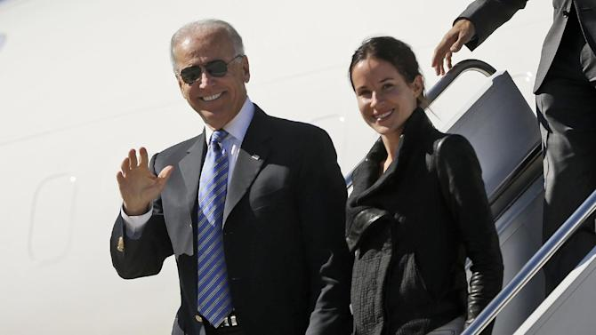 Vice President Joe Biden followed by his daughter Ashley Biden, arrives on Air Force Two at Lexington Blue Grass Airport, Thursday, Oct. 11, 2012, in Lexington, Ky. (AP Photo/Pablo Martinez Monsivais)