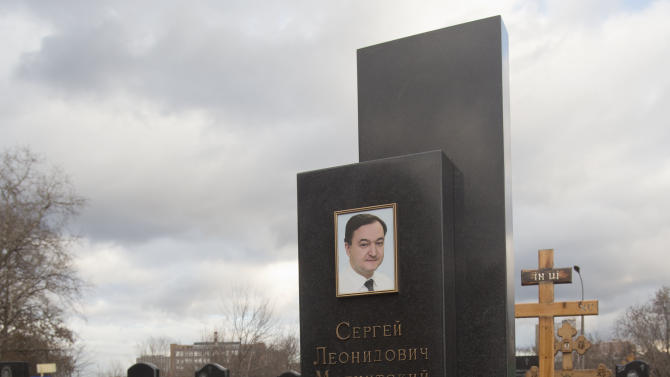 A tombstone on the grave of lawyer Sergei Magnitsky who died in jail, at a cemetery in Moscow, Friday, Nov. 16, 2012. U.S. lawmakers are expected to vote in a human rights legislation named after Magnitsky that would impose sanctions on Russian officials involved in human rights violations. (AP Photo/Misha Japaridze)
