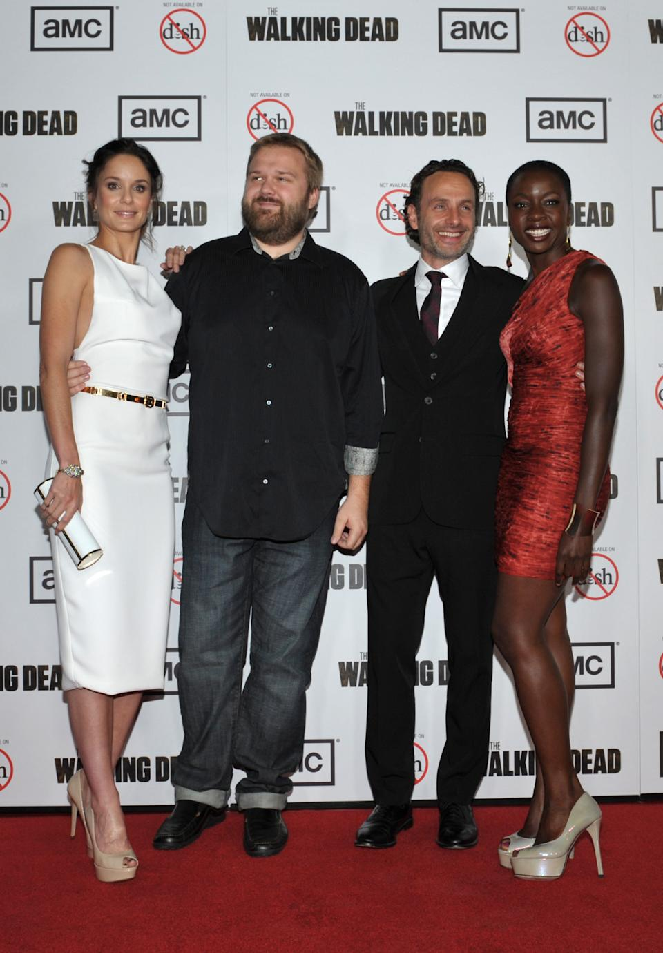 "FILE - In this Thursday, Oct. 4, 2012 file photo provided by AMC, from left, Sarah Wayne Callies, Robert Kirkman, Andrew Lincoln, and Danai Gurira attend the premiere of ""The Walking Dead"" at Universal Studios, in Los Angeles. (AP Photo/AMC, John Shearer)"