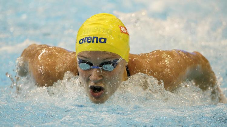 Sweden's Sarah Sjoestroem competes in a women's 100m butterfly first round heat at the LEN Swimming European Championships in Berlin, Germany, Thursday, Aug. 21, 2014. (AP Photo/Gero Breloer)