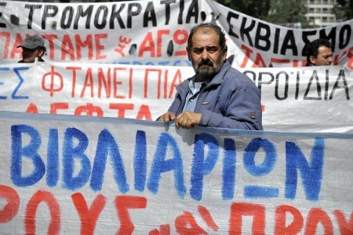 <p>Greek construction workers stand behind banners in front of the labour ministry in Athens on April 4 during their protest against the austerity measures and the unemployment in their sector. The eurozone debt crisis delivered more bad news on Monday with data showing record high unemployment of 11.1 percent and a manufacturing outlook at its lowest levels for three years.</p>