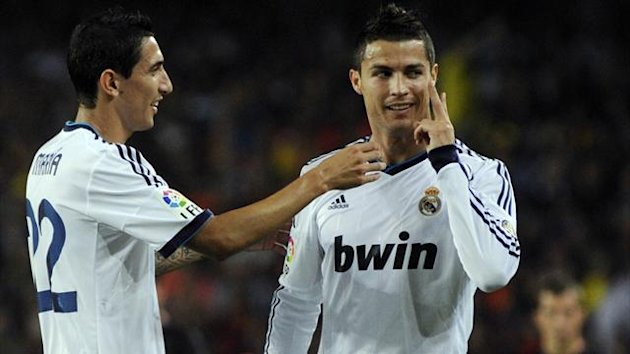 Real Madrid's Cristiano Ronaldo (R) celebrates with teammate Angel di Maria after scoring against Barcelona during their Spanish first division soccer match at Nou Camp stadium in Barcelona, October 7, 2012 (Reuters)
