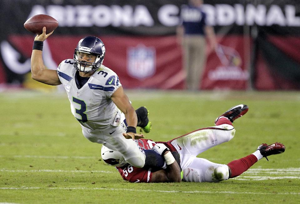 Wilson, Lynch lead Seattle past Cardinals, 34-22