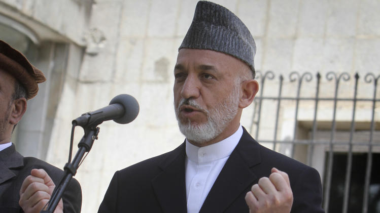 Afghan President Hamid Karzai speaks during a press event at the presidential palace in Kabul, Afghanistan, on Thursday, June 23, 2011.  Afghan President Hamid Karzai says his nation's youth will stand up and defend its country as the U.S. begins to pull troops out. (AP Photo/Musadeq Sadeq)