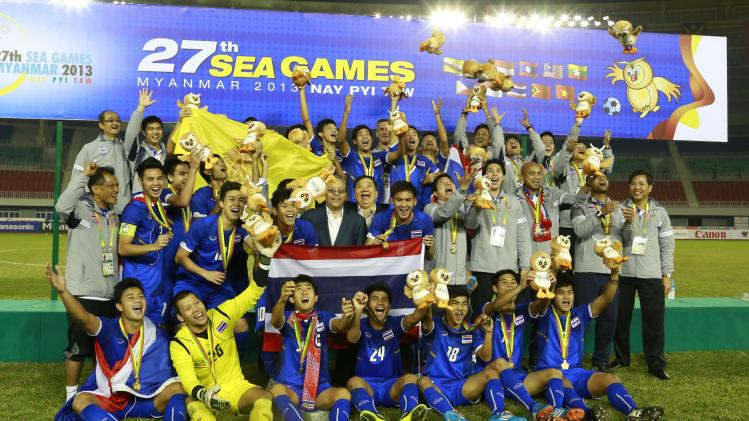 The Thailand team celebrates after winning their men's final soccer match against Indonesia at 27th SEA Games in Naypyitaw