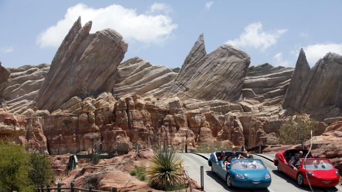"""This June 5, 2012 photo shows riders on the new Car Land attraction at Disney California Adventure in Anaheim, Calif. The park's five-year, $1 billion-plus revamp has debuted in spurts since 2008. Most of its new features rely on characters that come from Disney's $7.4 billion acquisition of Pixar Animation Studios, the San Francisco-area studio behind """"Cars,"""" """"Toy Story,"""" """"Monsters Inc."""" and """"A Bug's Life.""""  (AP Photo/Nick Ut)"""