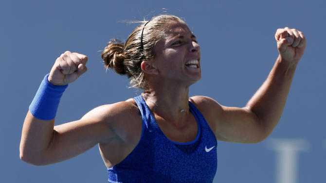 Sara Errani, of Italy, reacts after defeating Venus Williams, of the United States, during the third round of the 2014 U.S. Open tennis tournament, Friday, Aug. 29, 2014, in New York. (AP Photo/Matt Rourke)