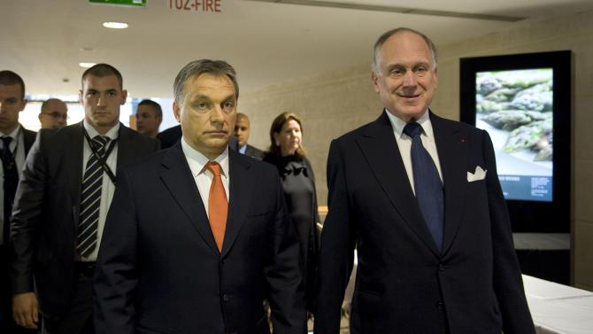 Hungarian Prime Minister Viktor Orban, center, and President of the World Jewish Congress Ronald S. Lauder, right, arrive at the opening dinner of the World Jewish Congress in Budapest, Hungary, Sunday, May 05, 2013. (AP Photo/MTI, Szilard Koszticsak)