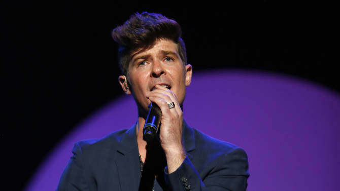 "FILE - This Sept. 15, 2012 file photo released by  Point Foundation shows Robin Thicke performing at ""Voices On Point"" Concert & Gala  in Los Angeles. Thisck's ""Blurred Lines,"" featuring T.I. & Pharrell was the top selling song on iTunes for the week ending June 17, 2013. (AP Photo/Point Foundation, Colin Young-Wolff)"