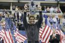 FILE - In this Sept. 9, 2013, file photo, Rafael Nadal, of Spain, holds up the championship trophy after winning the men's singles final over Novak Djokovic, of Serbia, at the 2013 U.S. Open tennis tournament in New York. Nadal will not defend his title at the U.S. Open because of an injured right wrist. Nadal and the tournament announced his withdrawal Monday, Aug. 18, 2014, a week before the year's last Grand Slam tournament begins. (AP Photo/Darron Cummings, File)