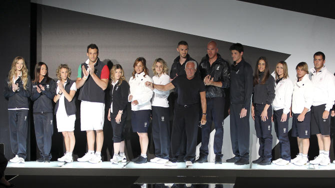 Fashion designer Giorgio Armani, foreground center, poses with Italian Olympic team athletes, wearing the official uniform he created for the London 2012 Olympic Games in Milan, Italy, Thursday, May 10, 2012. London is hosting the Summer Olympics from July 27-Aug.12. (AP Photo/Antonio Calanni)