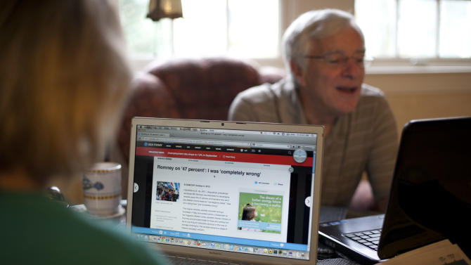 """In this photo taken Oct. 5, 2012, independent voters Thyra and Joe Galli read up on political news on Internet and with print newspapers at their home in Portsmouth, N.H. Thyra plans to vote for Obama and Joe is supporting Romney. New Hampshire's nickname is """"the Granite State"""" but there's nothing solid about its political landscape. Independent voters have been the reason in recent presidential elections. Today, former factory towns to the south _ Manchester and Nashua _ typically vote Republican as do the rural small towns up north, while state capital Concord and university towns like Durham, Dover, Keene and Hanover tend to lean Democratic. And the entire state is peppered with independents like Joe and Thyra Galli of Portsmouth. (AP Photo/Robert F. Bukaty)"""