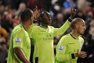 Christian Benteke, centre, scored a brace as Aston Villa defeated Swindon