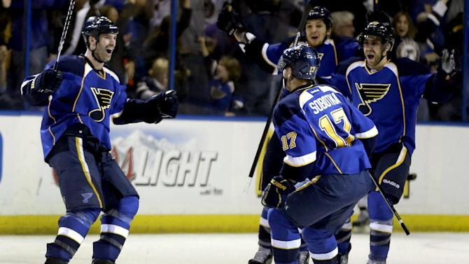 St. Louis Blues' Barret Jackman, left, is congratulated by Vladimir Sobotka (17), of the Czech Republic, Chris Stewart and Andy McDonald, right, after scoring winning goal during the third period in Game 2 of a first-round NHL hockey Stanley Cup playoff series against the Los Angeles Kings, Thursday, May 2, 2013, in St. Louis. The Blues won 2-1. (AP Photo/Jeff Roberson)