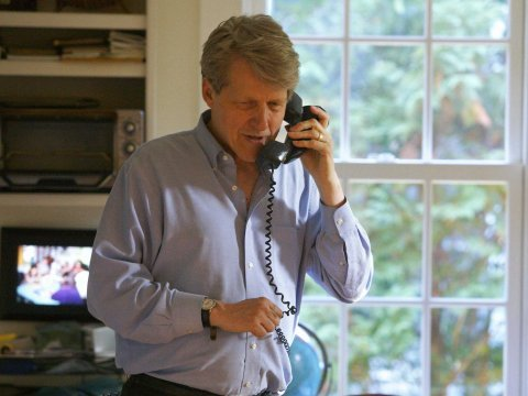 Robert Shiller, one of three American scientists who won the 2013 economics Nobel prize, speaks on the phone at his home in New Haven, Connecticut Oct...