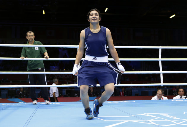 Tajikistan's Mavzuna Chorieva curtsies after winning her quarterfinal Women's Light (60kg) boxing match against China's Dong Cheng at the London Olympic Games