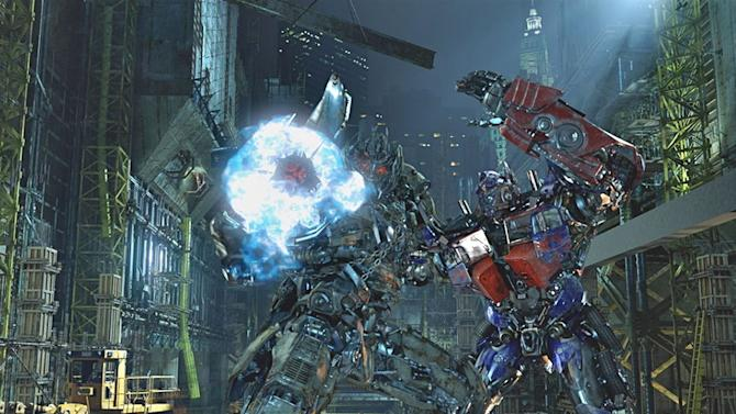 """In this undated image released by Universal Studios Hollywood, characters Megatron, left, and Optimus Prime are displayed during the """"Transformers the Ride: 3D,"""" attraction at Universal Studios Hollywood in Los Angeles. Debuting May 25 at Universal Studios Hollywood, the ride, based on the film franchise, offers motion-simulator vehicles and 3D high definition video. (AP Photo/Universal Studios Hollywood)"""