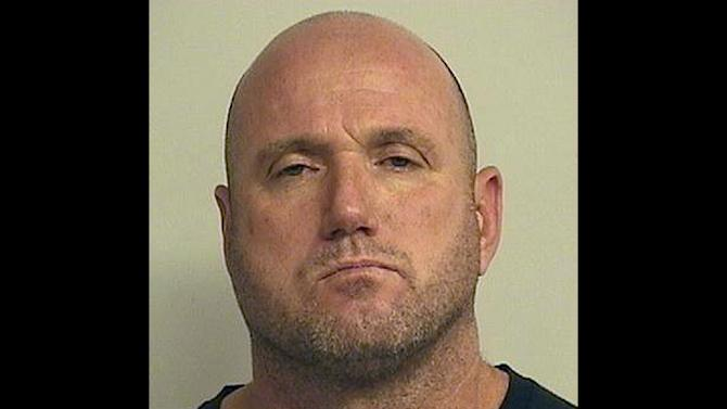 This booking photograph released by the Tuscaloosa County Sheriff's Department shows Nathan Van Wilkins, 44, who was charged in an early morning shooting that left 17 people injured in a bar in Tuscaloosa, Ala., on Tuesday, July 17, 2012. Police said Wilkins was charged initially with one count of attempted murder, but other charges will be filed. (AP Photo/Tuscaloosa County Sheriff's Department)