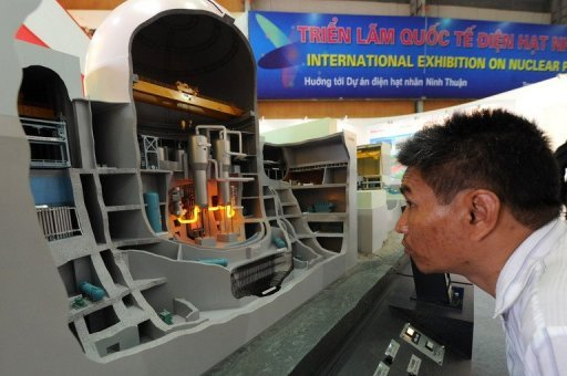 <p>This file photo shows a visitor looking at a model of Japanese-made nuclear reactor model at an exhibition on nuclear power in Hanoi, in 2010. Tokyo Electric Power Co. is to abandon plans to export its nuclear power plant expertise as it struggles to cope with the Fukushima disaster, news reports said Thursday.</p>