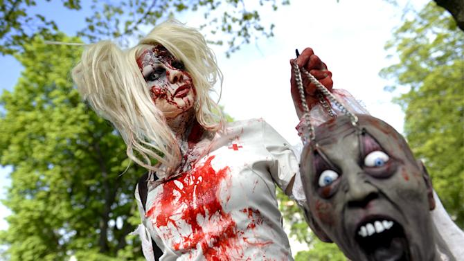 Participants of the Zombie Walk Helsinki 2015 gather at a Helsinki park before marching in Helsinki