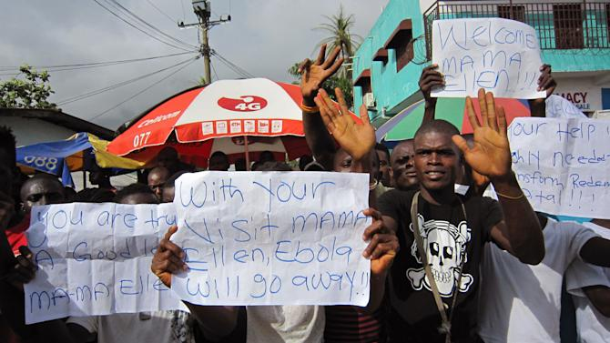 "FILE -In this file photo taken on Tuesday, June 17, 2014, people protest outside a hospital as Liberia President Ellen Johnson Sirleaf visit's the area after Ebola death's in Monrovia, Liberia. A senior official for Doctors Without Borders says the Ebola outbreak ravaging West Africa is ""totally out of control"" and that the medical group is stretched to the limit in its capacity to respond. Bart Janssens, the director of operations for the group in Brussels, said Friday, June 20, 2014, that international organizations and the governments involved need to send in more health experts and to increase the public education messages about how to stop the spread of the disease. (AP Photo/Jonathan Paye-Layleh,File)"