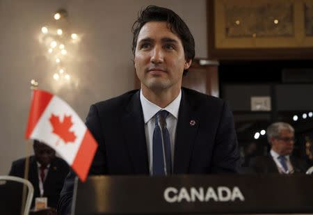 Canada backs U.S.: climate deal should not be legally binding
