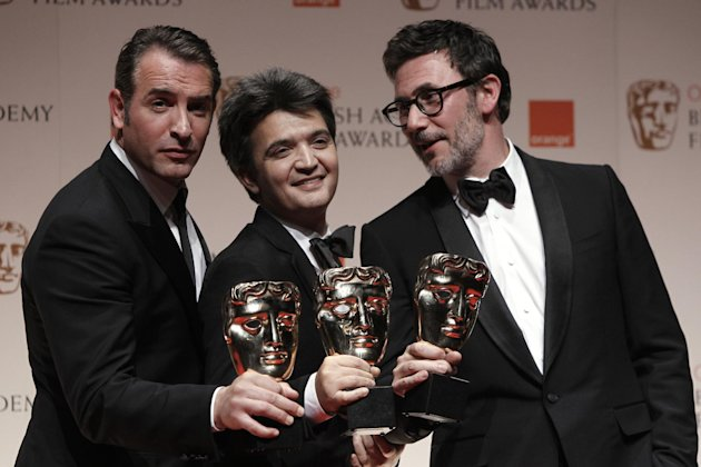 Actor Jean Dujardin, producer Thomas Langmann and director Michel Hazanavicius with the awards for 'Best Leading Actor, Best Film and Best Director' all for the film 'The Artist' backstage at the BAFTA Film Awards 2012, at The Royal Opera House in London, Sunday, Feb. 12, 2012. (AP Photo/Joel Ryan)