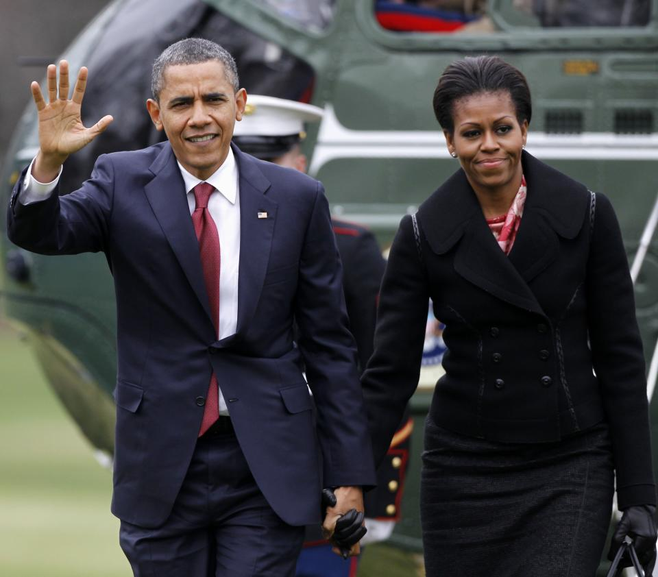 President Barack Obama and First Lady Michelle Obama arrive on the South Lawn of the White House in Washington, Wednesday, Dec. 14, 2011. (AP Photo/Haraz N. Ghanbari)