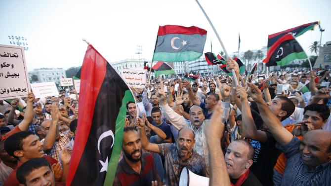 Supporters of Operation Dawn, a group of forces mainly from Misrata, demonstrate against the Libyan parliament at Martyrs' Square in Tripoli