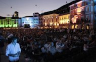 Spectators are seated in front of the giant screen at the Piazza Grande during the 62nd Locarno International Film Festival in 2009. French actress Jeanne Moreau lights up the big screen at the Locarno Film Festival Saturday in a film inspired by a story of friendship between two Estonian women in Paris