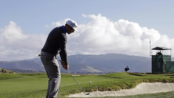 Hunter Mahan chips the ball onto the 17th green of the Pebble Beach Golf Links during the first round of the AT&T Pebble Beach Pro-Am golf tournament  Thursday, Feb. 7, 2013 in Pebble Beach, Calif. (AP Photo/Eric Risberg)