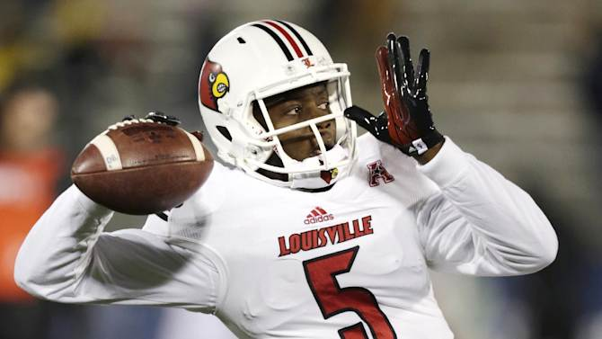 FILE -In this Nov. 8, 2013, file photo, Louisville quarterback Teddy Bridgewater warms up for an NCAA college football game against Connecticut, in East Hartford, Conn. Bridgewater was selected in the first round, 32nd overall, by the Minnesota Vikings in the NFL draft on Thursday, May 8, 2014