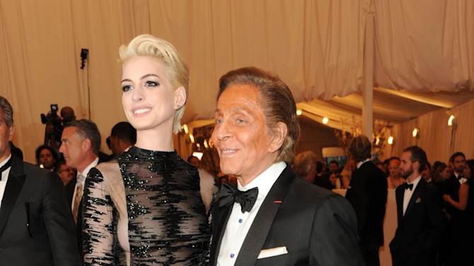 """Actress Anne Hathaway and designer Valentino Garavani attend The Metropolitan Museum of Art's Costume Institute benefit celebrating """"PUNK: Chaos to Couture"""" on Monday, May 6, 2013 in New York. (Photo by Evan Agostini/Invision/AP)"""