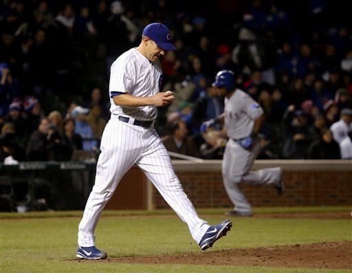 Holland pitches Rangers past Cubs 4-2