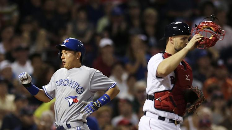 Toronto Blue Jays' Munenori Kawasaki scores on a single off Boston Red Sox starting pitcher Clay Buchholz by teammate Ryan Goins during the fourth inning of a baseball game at Fenway Park in Boston, Monday, July 28, 2014. At right is Boston Red Sox catcher David Ross. (AP Photo/)