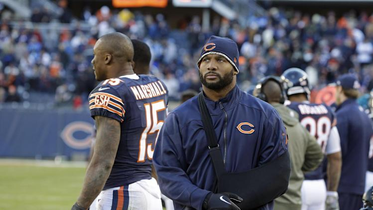 In this Nov. 10, 2013 file photo, injured Chicago Bears linebacker Lance Briggs walks on the sidelines during an NFL football game against the Detroit Lions in Chicago. Briggs, sidelined the past two months by a shoulder injury, hopes to receive medical clearance to play against the Philadelphia Eagles on Sunday, Dec. 22, 2013